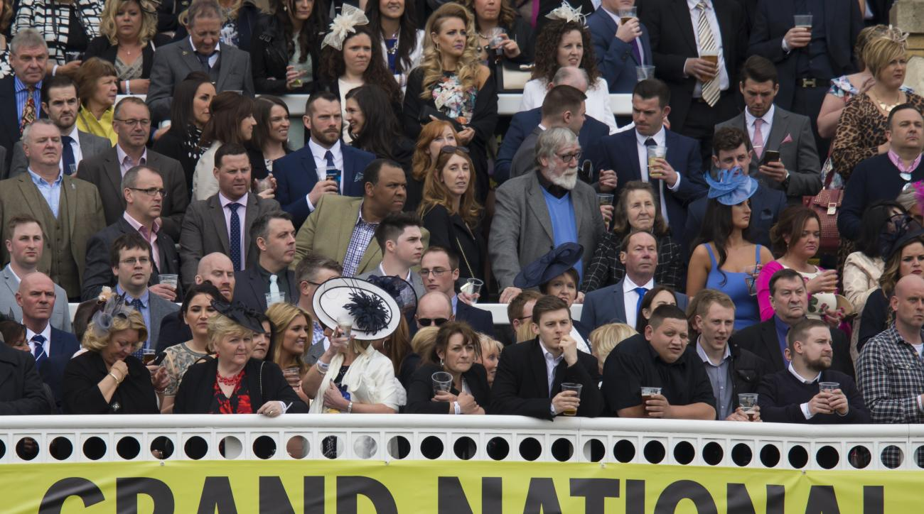 Members of the public fill the stands before the Grand National horse race at Aintree Racecourse Liverpool, England, Saturday, April 9, 2016. (AP Photo/Jon Super)