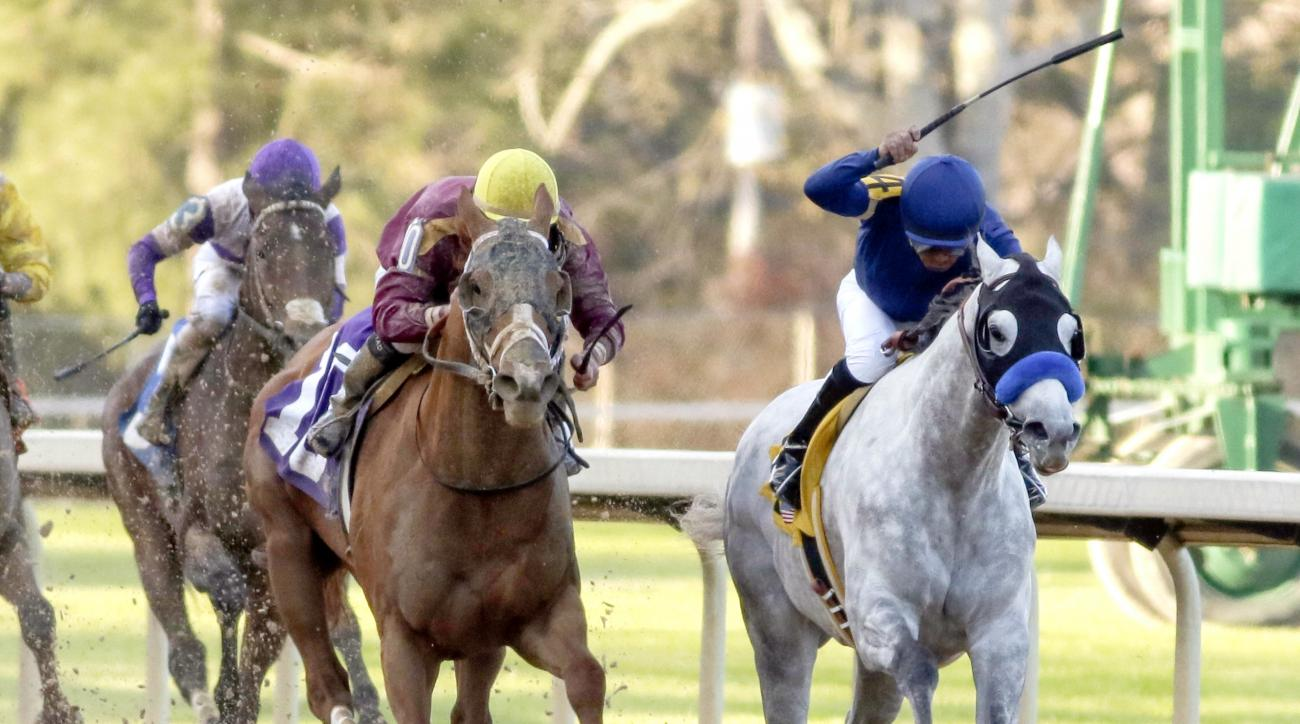 FILE - In this March 19, 2016, file photo, Cupid and jockey Martin Garcia, right, battles Whitmore and jockey Irad Ortiz, Jr., center, down the stretch to win the Rebel Stakes horse race at Oaklawn Park in Hot Springs, Ark. The colt, winner of last months