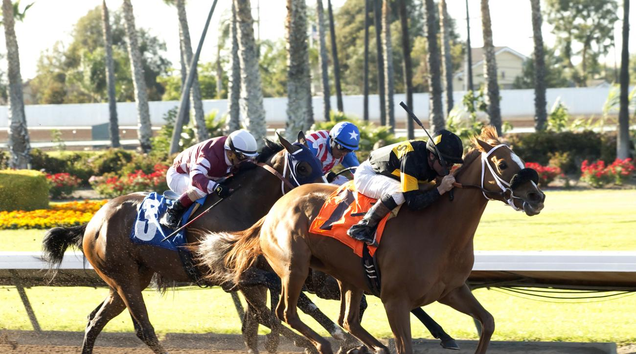 In a photo provided by Benoit Photo, Finest City and jockey Kent Desormeaux, right, outleg Lost Bus, left, with Fernando Perez, and Fantastic Style, with Rafael Bejarano, inside, to win the Grade II, $200,000 Great Lady M Stakes horse race Saturday, April