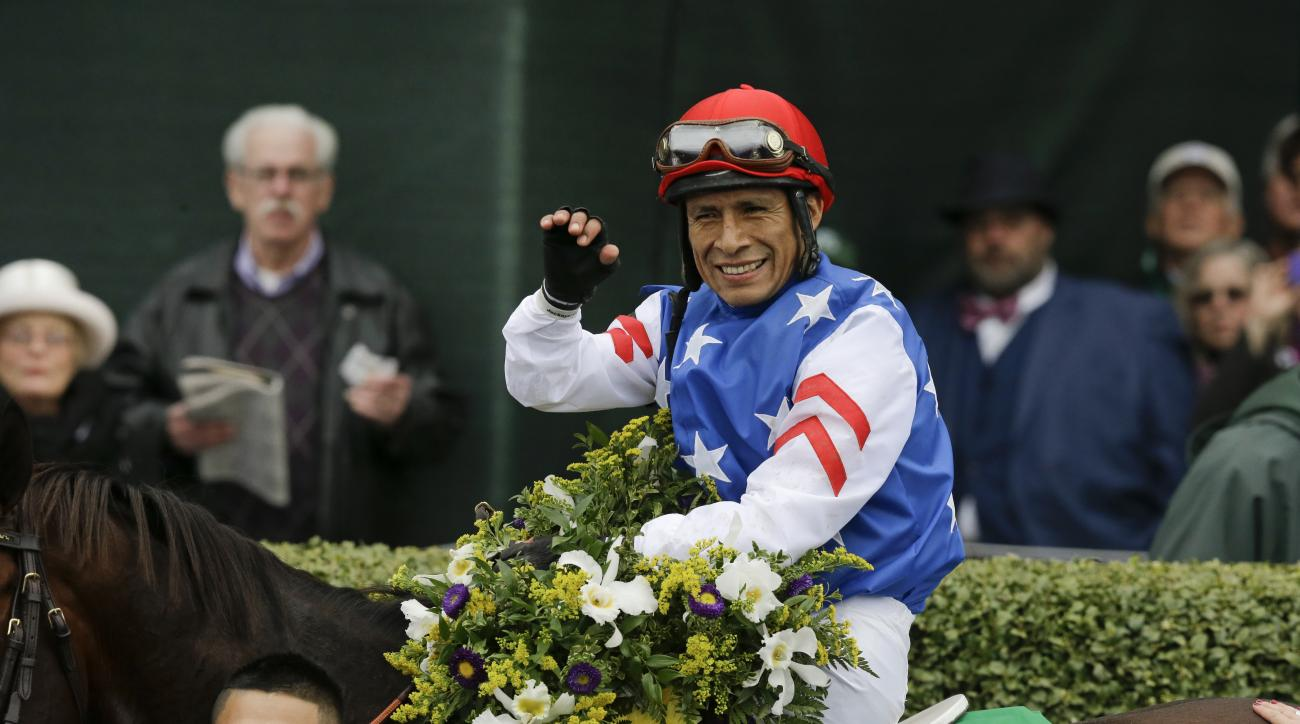 Jockey Edgar Prado sits atop Runhappy in the winner's circle after winning the Breeders' Cup Sprint horse race at Keeneland race track Saturday, Oct. 31, 2015, in Lexington, Ky. (AP Photo/Garry Jones)