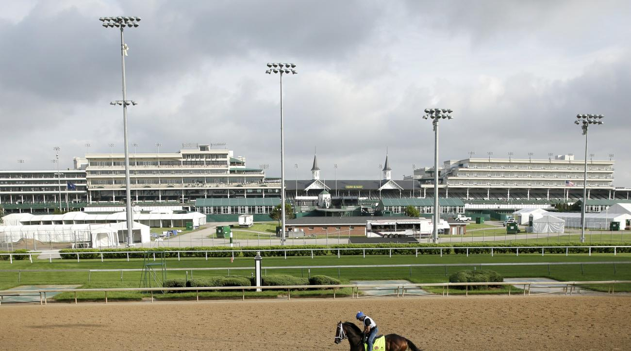 Kentucky Derby hopeful Dazzling Gem is ridden by exerciser rider Fernano Espinoza during a workout at Churchill Downs Monday, May 2, 2016, in Louisville, Ky. The 142nd running of the Kentucky Derby is scheduled for Saturday, May 7. (AP Photo/Charlie Riede