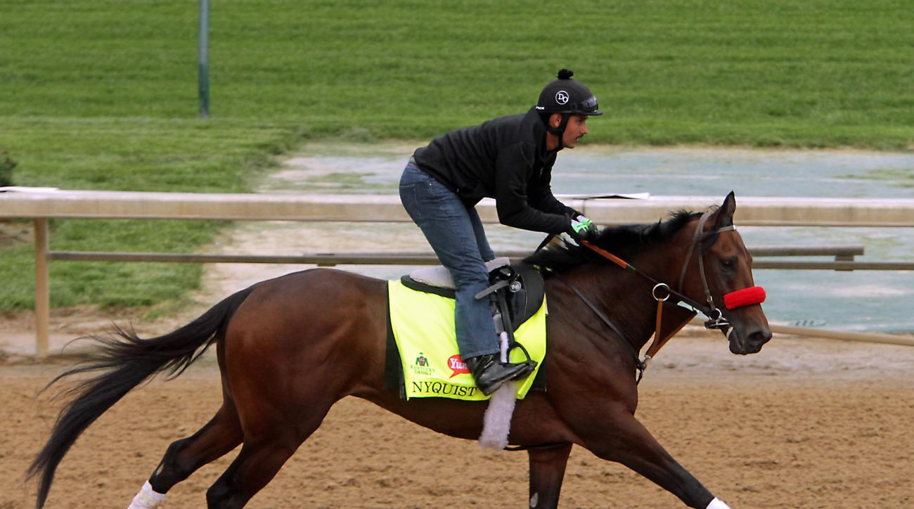 Kentucky Derby hopeful Nyquist, ridden by Jonny Garcia, gallops at Churchill Downs in Louisville, Ky., Tuesday, May 3, 2016. The 142nd Kentucky Derby is Saturday, May 7. (AP Photo/Garry Jones)
