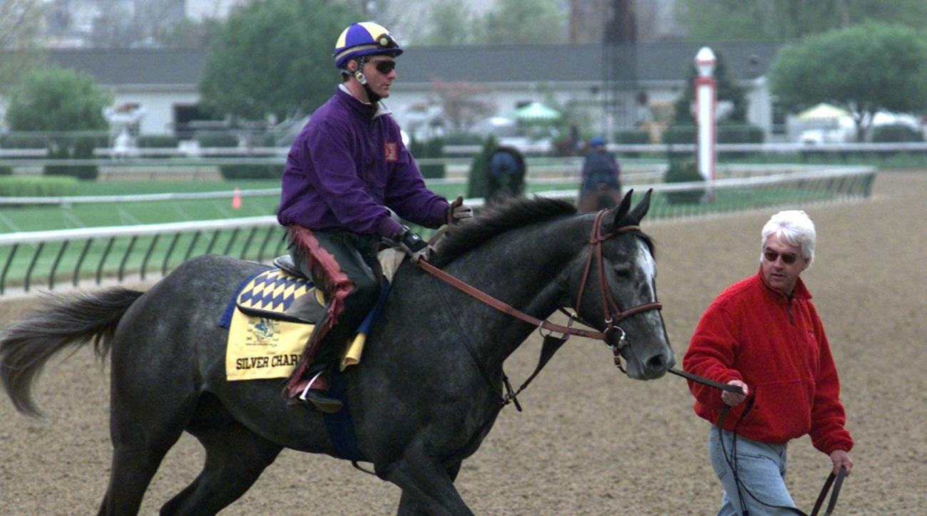 FILE - In this May 1, 1997, file photo, Kentucky Derby entry Silver Charm, with exercise rider Larry Demore up, is led off the track at Churchill Downs in Louisville, Ky., by trainer Bob Baffert. Baffert is back at Churchill Downs bidding for his fifth ca
