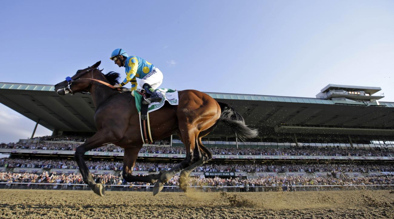 FILE - In this June 6, 2015, file photo, American Pharoah, ridden by jockey Victor Espinoza, gallops past the grandstand after crossing the finish line to win the 147th running of the Belmont Stakes horse race at Belmont Park in Elmont, N.Y. Life is good