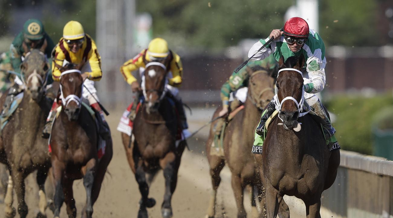 Javier Castellano rides Cathryn Sophia to victory in the 142nd running of the Kentucky Oaks horse race at Churchill Downs Friday, May 6, 2016, in Louisville, Ky. (AP Photo/Darron Cummings)