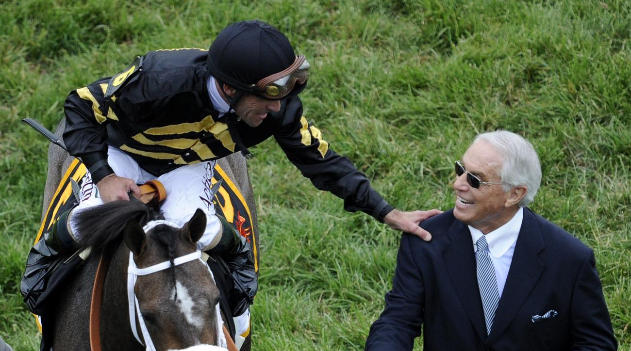 FILE- In this May 18, 2013, file photo, jockey Gary Stevens, aboard Oxbow, celebrates with trainer D. Wayne Lukas after winning the Preakness Stakes horse race at Pimlico Race Course in Baltimore. (AP Photo/Nick Wass, File)