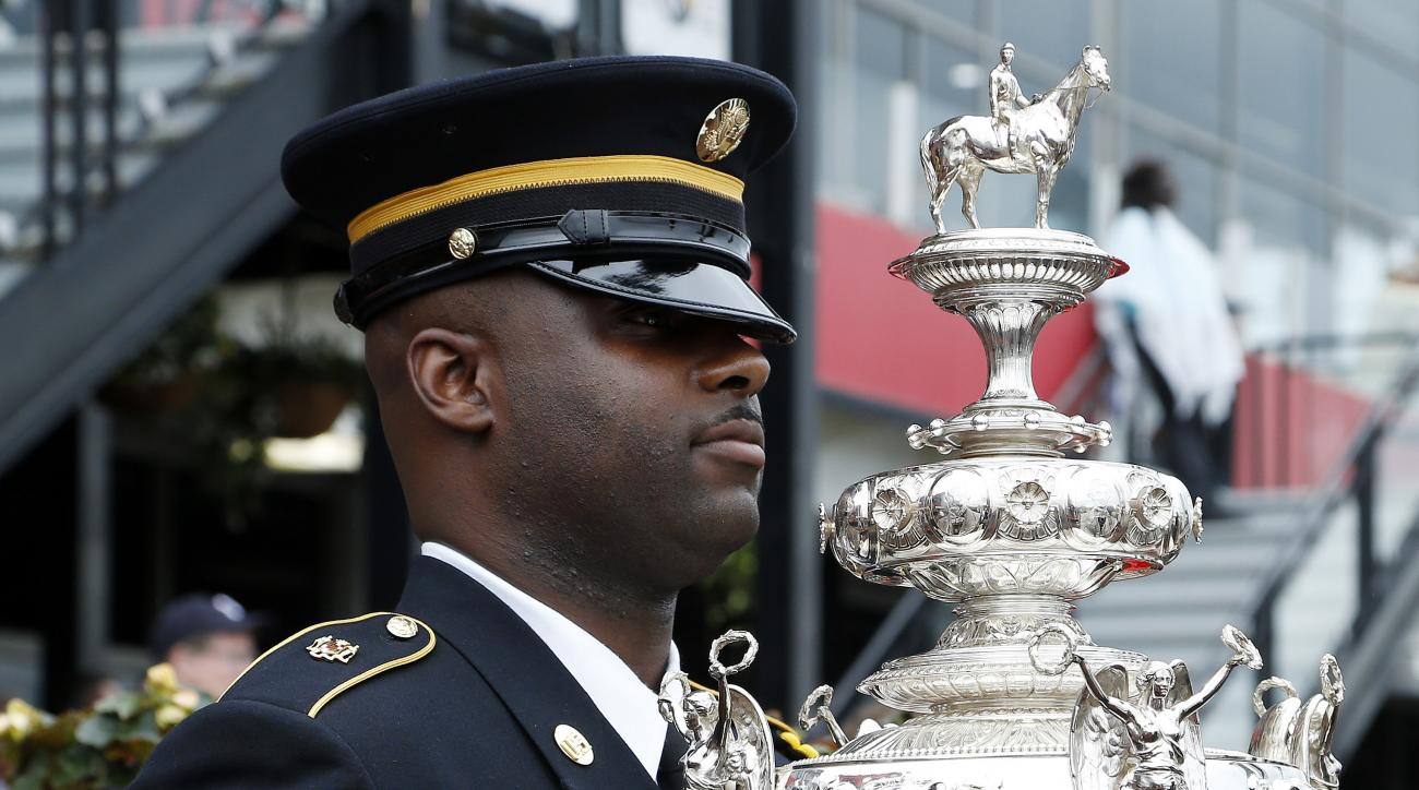 The Woodlawn Vase is moved by Army 1st Sgt. Jonathan McGlone ahead of the 141st Preakness Stakes horse race at Pimlico Race Course, Saturday, May 21, 2016, in Baltimore. The Woodlawn Vase  is an American trophy given annually to the winning owner of the P