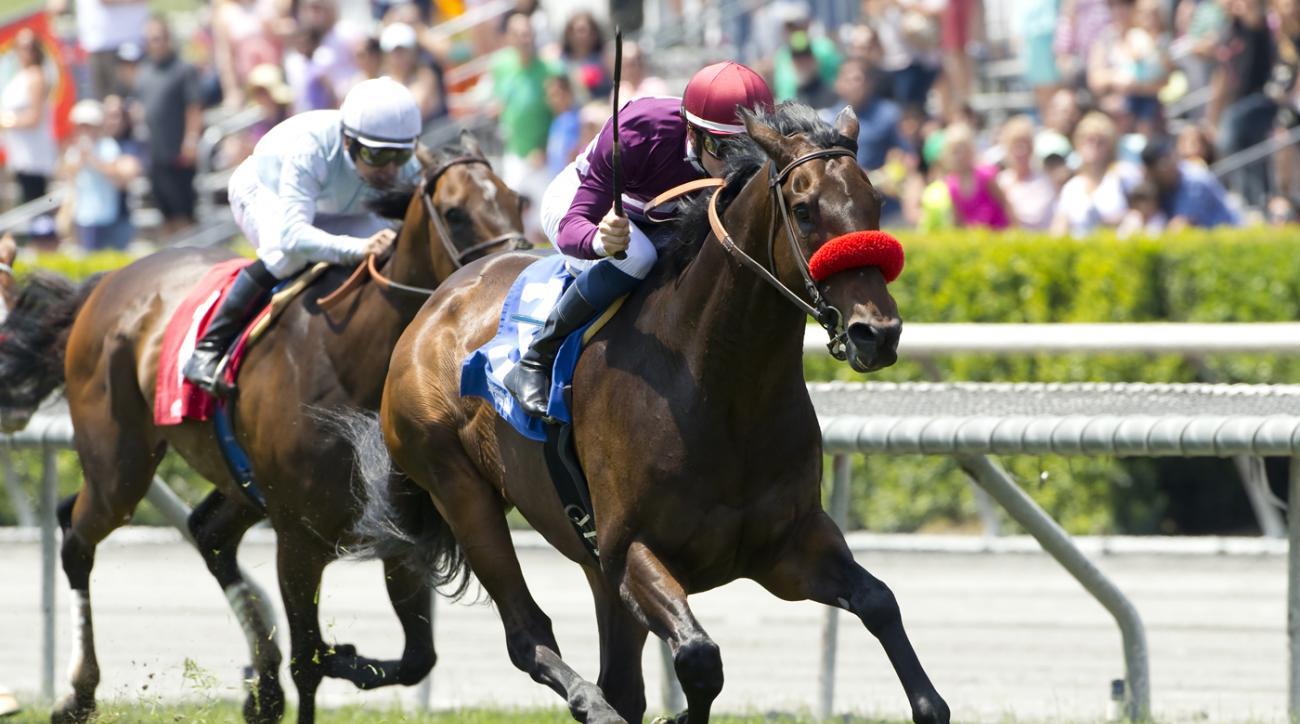 In this image provided by Benoit Photo, Ambitious Brew and jockey Flavien Prat win the Lennyfromalibu Stakes horse race, Saturday, May 28, 2016 at Santa Anita Park, Arcadia Calif. (Benoit Photo via AP)