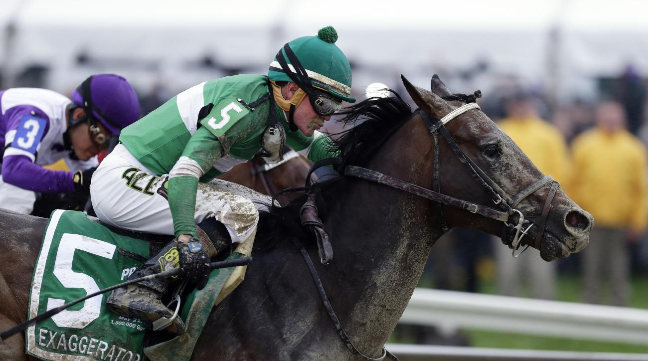 FILE - In this May 21, 2016, file photo, Exaggerator (5), with Kent Desormeaux, aboard moves past Nyquist, ridden by Mario Gutierrez, on the way to winning the 141st Preakness Stakes horse race at Pimlico Race Course in Baltimore. Next Saturday there'll b