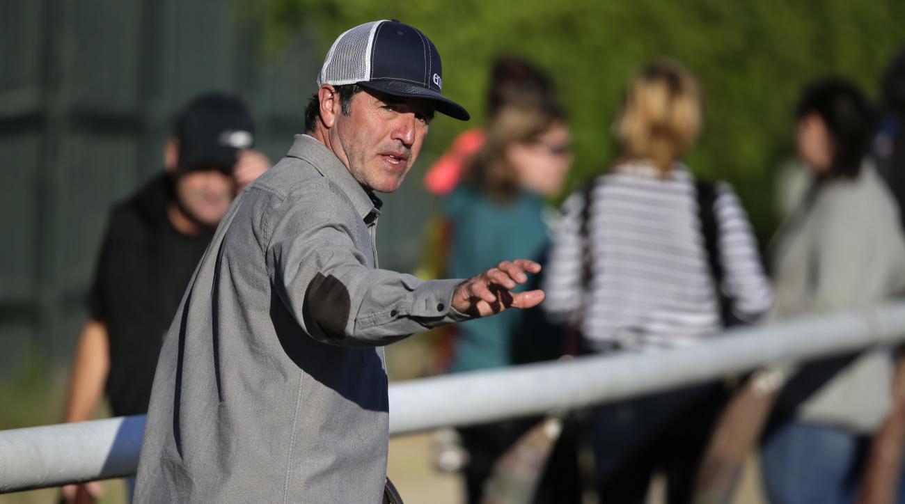 Keith Desormeaux, trainer for Belmont Stakes hopeful Exaggerator, walks onto the main track, Friday, June 10, 2016, in Elmont, N.Y. Exaggerator will compete in the 148th running of the Belmont Stakes Horse Race on Saturday. (AP Photo/Julie Jacobson)