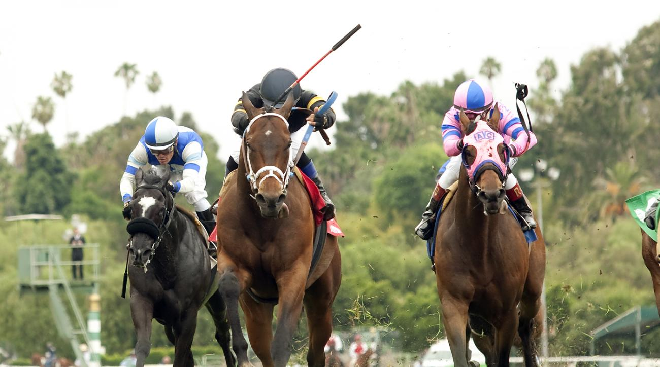 Poshsky and jockey Fernando Perez, second from left, outleg Zinvoe, ridden by Santiago Gonzalez, left, and Ashleyluvssugar, ridden by Rafael Bejarano, right, to win the $100,000 Crystal Water Stakes horse race, Saturday, June 11, 2016 at Santa Anita Park,
