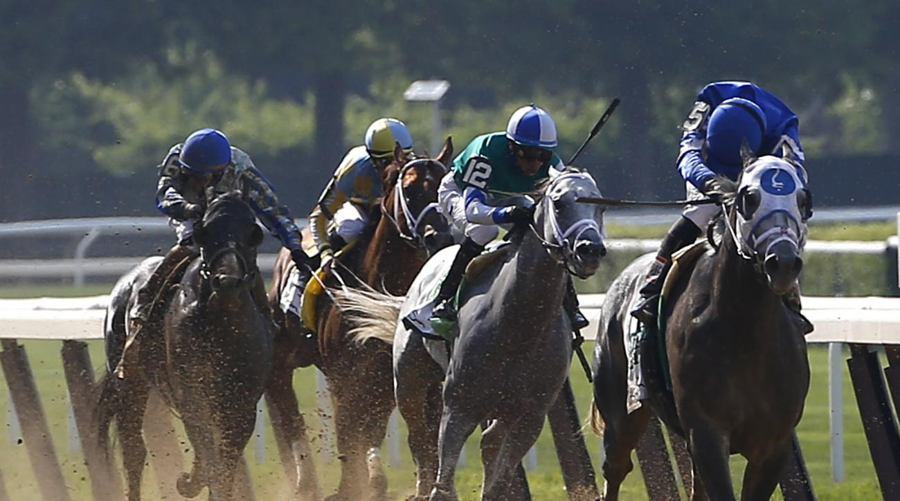Jockey Joel Rosario, riding Frosted, right, looks behind him on the home stretch before winning the ninth race, the Mohegan Sun Metropolitan, at Belmont Park, Saturday, June 11, 2016, in Elmont, N.Y. The 148th running of the Belmont Stakes horse race will