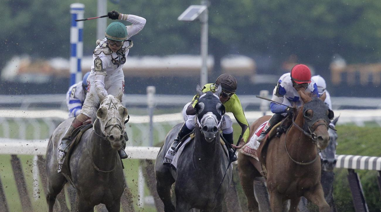 Creator, left, with jockey Luis Saez up, wins the 148th running of the Belmont Stakes horse race, Saturday, June 11, 2016, in Elmont, N.Y. (AP Photo/Peter Morgan)