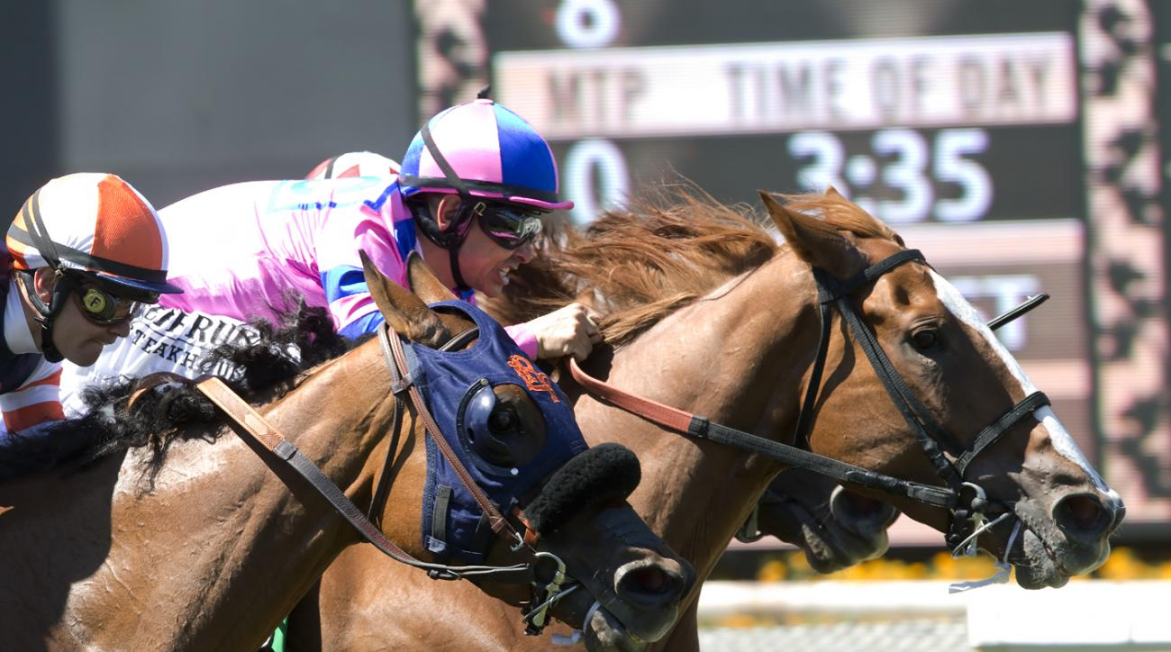 In a photo provided by Benoit Photo, Cheekaboo and jockey Mike Smith, right, overpower Stays in Vegas (Alex Solis), inside, Be Mine (Flavien Prat), left, to win the Grade II, $200,000 Honeymoon Stakes, Sunday, June 19, 2016 at Santa Anita Park, Arcadia, C