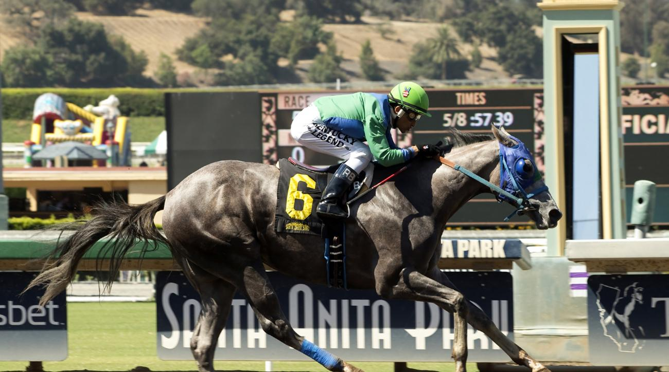 In this image provided by Benoit Photo, Theonewewaitedfor, with Rafael Bejarano aboard, wins the $125,000 Landaluce Stakes horse race Saturday, July 9, 2016, at Santa Anita Park in Arcadia Calif. (Benoit Photo via AP)