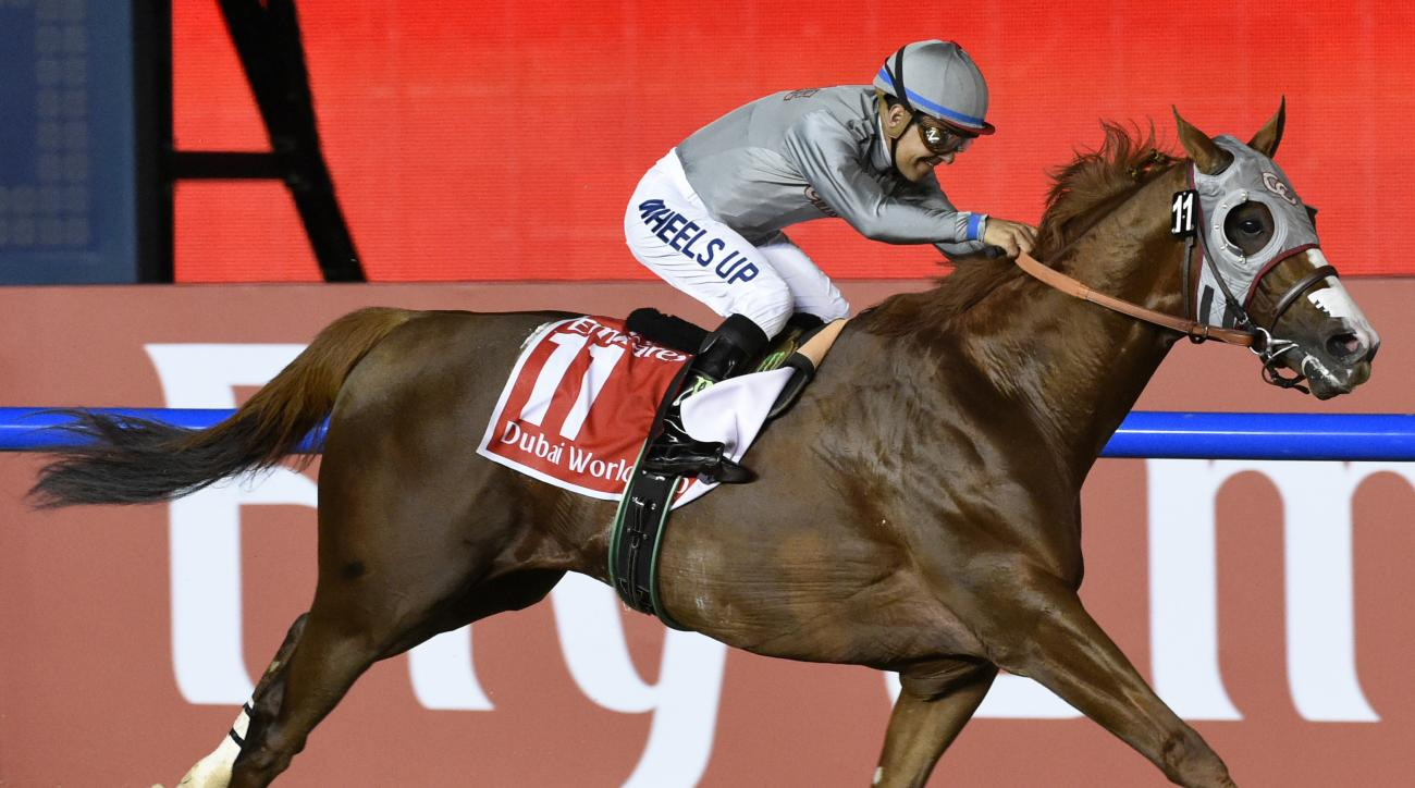 FILE - In this Saturday, March 26, 2016, file photo, California Chrome, idden by Victor Espinoza, wins the Dubai World Cup horse race at Meydan Racecourse in Dubai, United Arab Emirates. Horse racings summer season kicks off in a big way this weekend at t