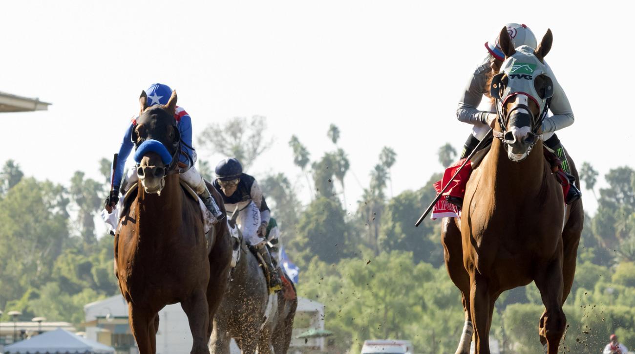 California Chrome and Victor Espinoza cruise to a facile win in the $300,000 Awesome Again Stakes at Santa Anita Saturday, Oct. 1, 2016, in Arcadia, Calif.  Dortmund and Rafael Bejarano, left, finish second. (Benoit Photo via AP)