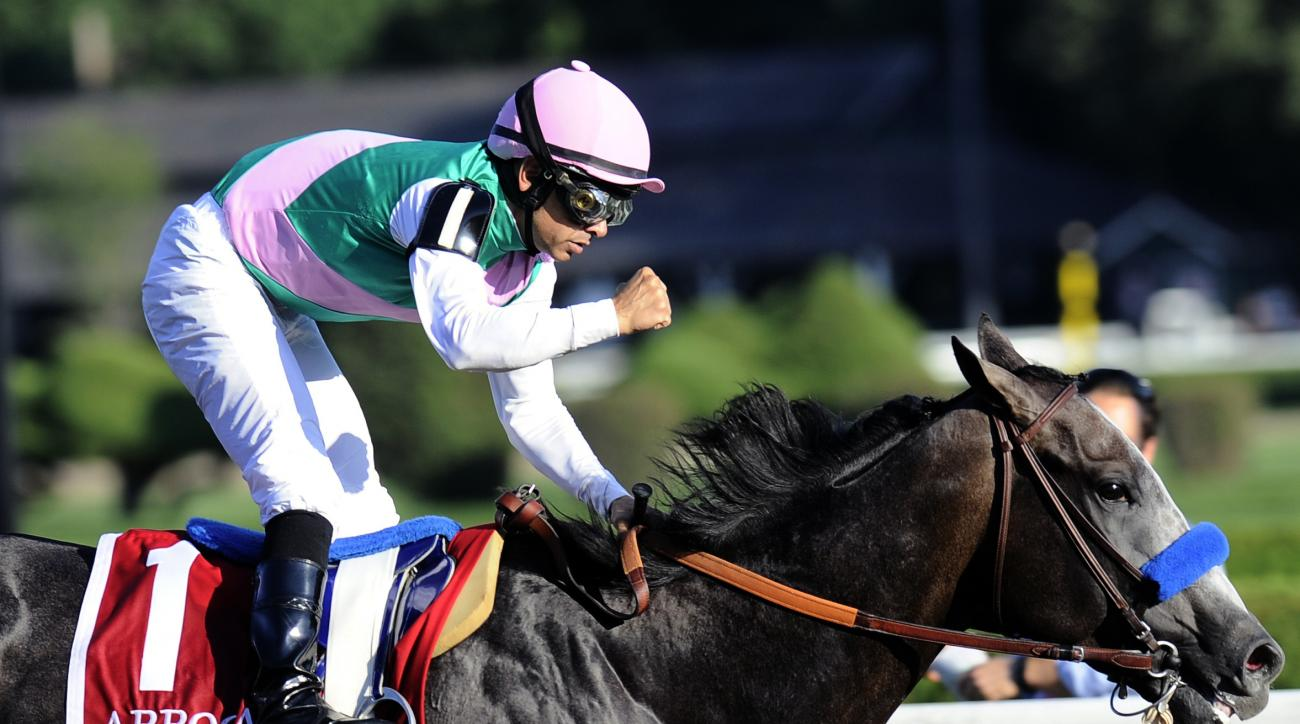FILE - In this Aug. 27, 2016, file photo, Jockey Mike Smith celebrates aboard Arrogate after winning the Travers Stakes horse race at Saratoga Race Course in Saratoga Springs, N.Y. The ride is far from over for Smith, even at age 51. The jockey known as ""