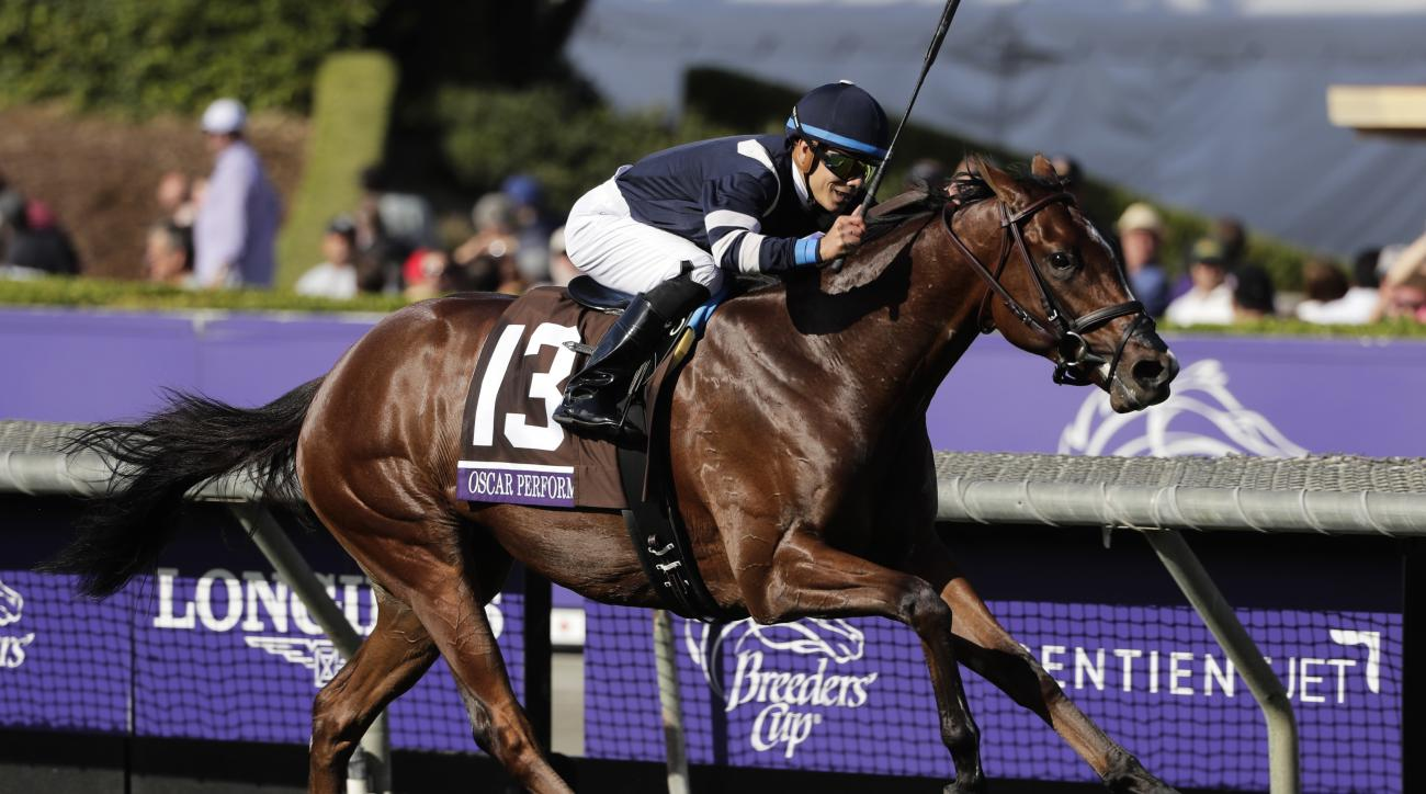 Jockey Jose Ortiz rides Oscar Performance to victory in the Breeders' Cup Juvenile Turf horse race at Santa Anita, Friday, Nov. 4, 2016, in Arcadia, Calif. (AP Photo/Jae C. Hong)