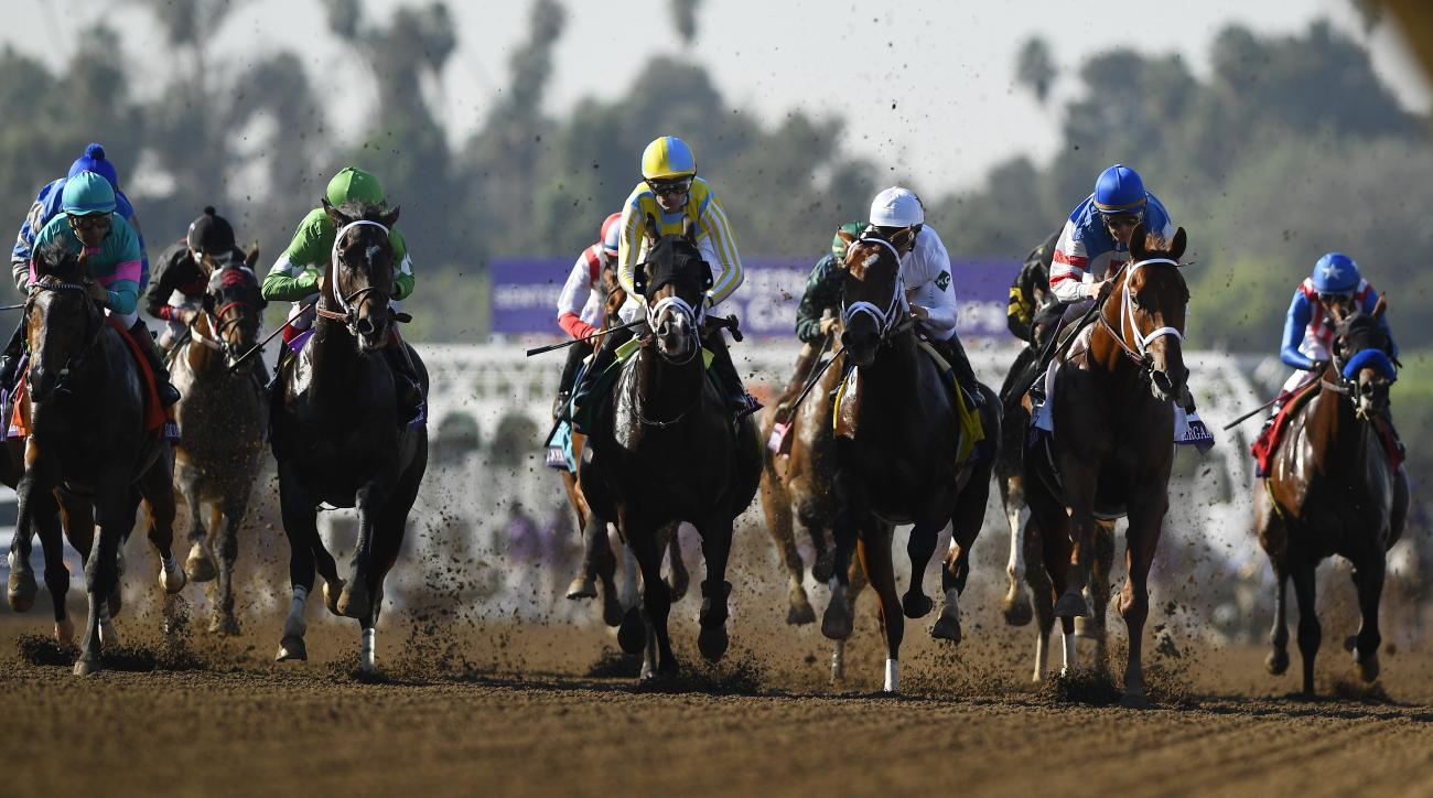 Julien Velasquez, center, rides Classic Empire to victory in the Breeders' Cup Juvenile horse race at Santa Anita, Saturday, Nov. 5, 2016, in Arcadia, Calif. (AP Photo/Mark J. Terrill)