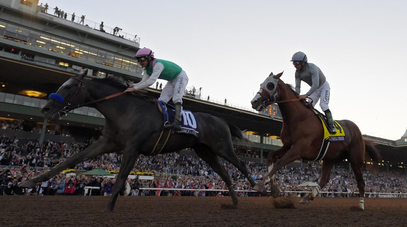 Arrogate with jockey Mike Smith, left, wins the Breeders' Cup Classic horse race over California Chrome, center, with Victor Espinoza at Santa Anita, Saturday, Nov. 5, 2016, in Arcadia, Calif. (AP Photo/Mark J. Terrill)