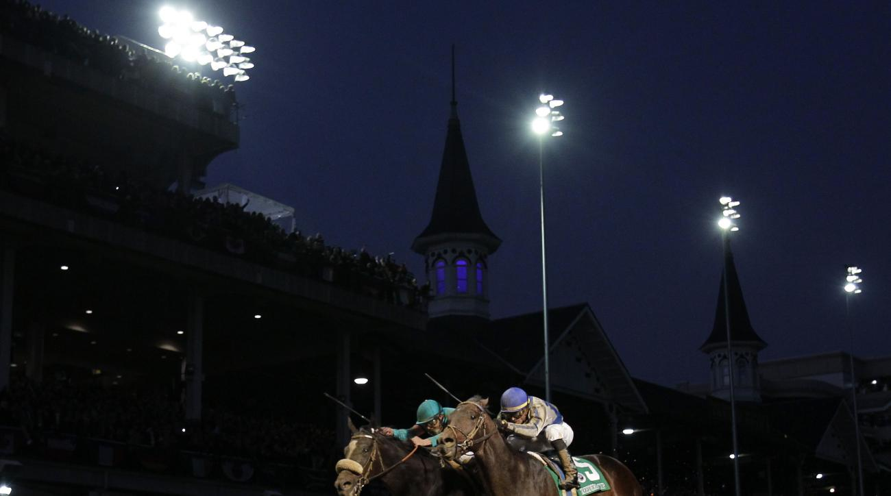 FILE - In this Nov. 6, 2010, file photo, jockey Garrett Gomez, right, rides Blame to victory in the Breeder's Cup Classic horse race at Churchill Downs in Louisville, Ky. Gomez, who won nearly 4,000 races in a 25-year career and was among the greatest joc
