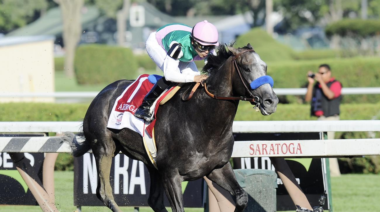 FILE - In this Aug. 27, 2016, file photo, Arrogate, with Mike Smith aboard, sets a track record winning The Travers Stakes horse race at Saratoga Race Course in Saratoga Springs, N.Y. California Chrome and Arrogate were among the finalists announced Thurs