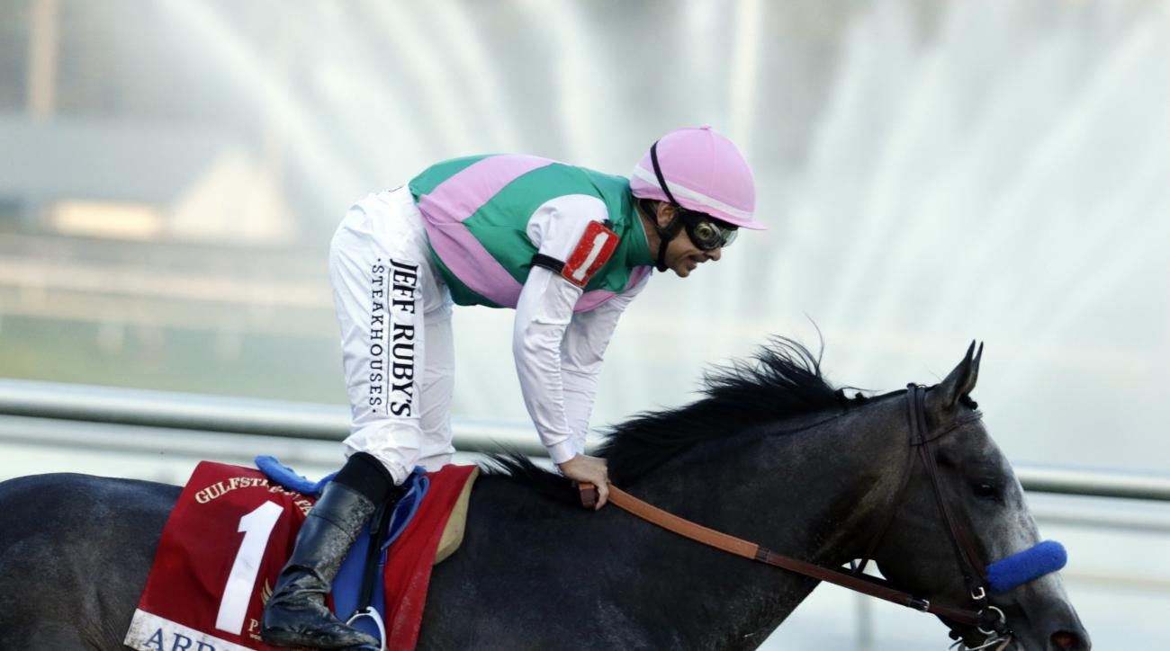 FILE- In this Saturday, Jan. 28, 2017 file photo, jockey Mike Smith passes the finish line riding Arrogate to win the inaugural running of the $12 million Pegasus World Cup horse race at Gulfstream Park in Hallandale Beach, Fla. Having taken over the mant