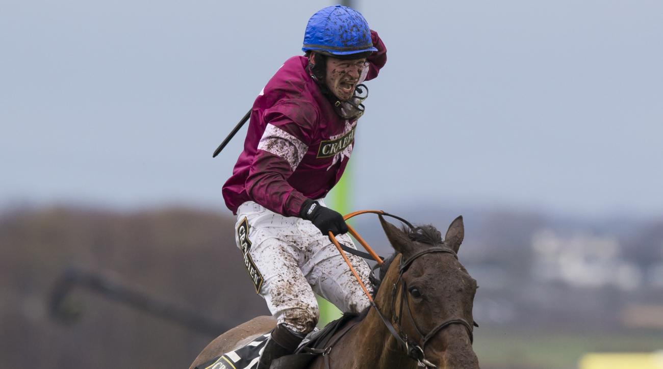 FILE - This is a  Saturday, April 9, 2016 file photo of David Mullins celebrates as he wins the Grand National horse race on Rule The World at Aintree Racecourse Liverpool, England.  This year's race will be held on Saturday April 8, 2017 and last years w