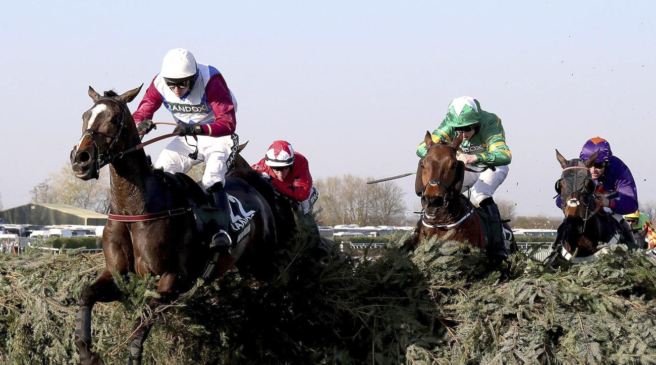 One For Arthur ridden by jockey Derek Fox jumps the last on the way to winning the the Grand National horse race on Grand National Day at the Aintree Racecourse, Liverpool, England, Saturday April 8, 2017. (Niall Carson/PA via AP)