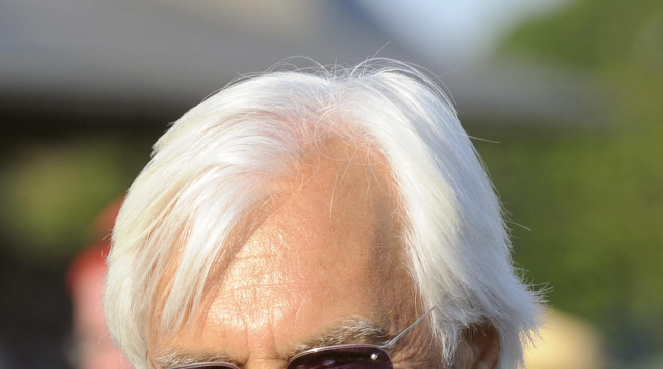 FILE - This Aug. 27, 2016 file photo shows trainer Bob Baffert after Arrogate and jockey Mike Smith won the Travers Stakes horse race at Saratoga Race Course in Saratoga Springs, N.Y. Baffert went from thinking he could win a fifth Kentucky Derby to being