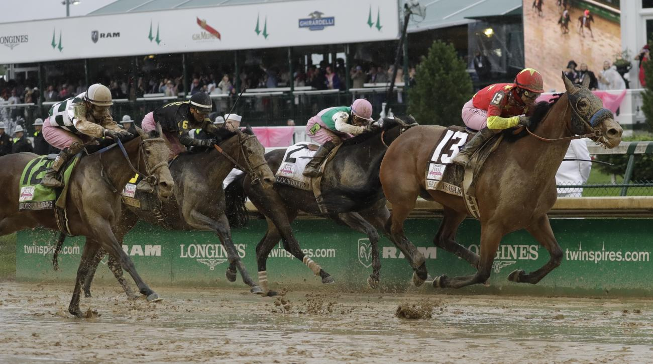 Mike Smith rides Abel Tasman to victory in the 143rd running of the Kentucky Oaks horse race at Churchill Downs Friday, May 5, 2017, in Louisville, Ky. (AP Photo/Morry Gash)