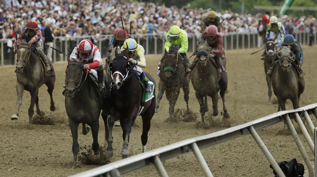 Cloud Computing (2), ridden by Javier Castellano, second from left, wins142nd Preakness Stakes horse race at Pimlico race course as Classic Empire (5) with Julien Leparoux aboard takes second, Saturday, May 20, 2017, in Baltimore. (AP Photo/Matt Slocum)