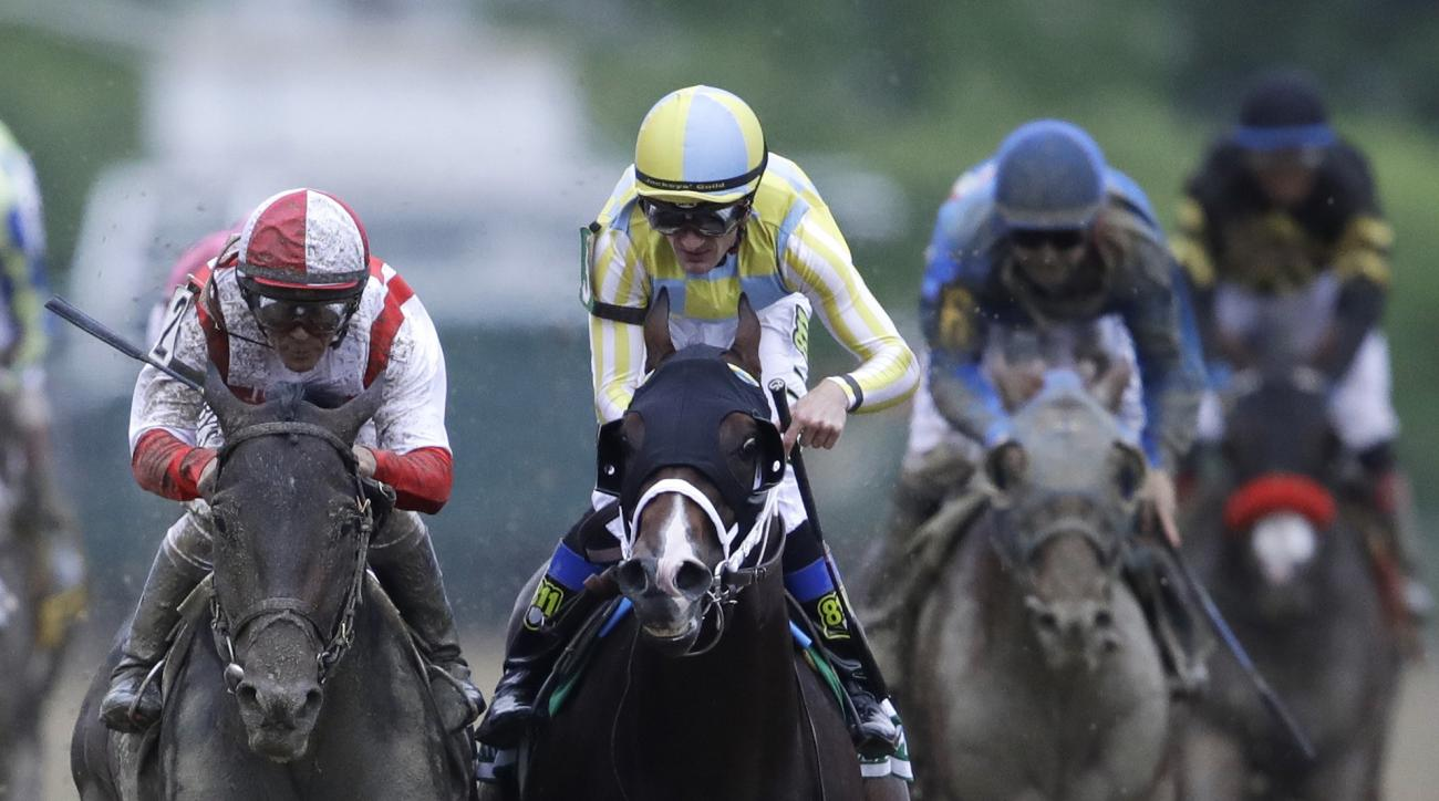 Cloud Computing, left, ridden by Javier Castellano, second from left, wins142nd Preakness Stakes horse race at Pimlico race course as Classic Empire (5) with Julien Leparoux aboard takes second, Saturday, May 20, 2017, in Baltimore. (AP Photo/Patrick Sema