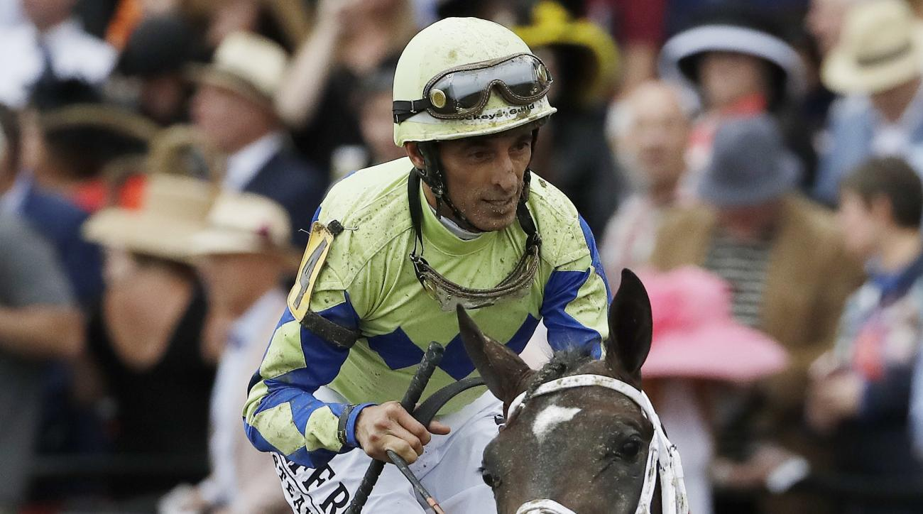 Always Dreaming ride by John Velazquez moves off the track after the running of the 142nd Preakness Stakes horse race at Pimlico race course, Saturday, May 20, 2017, in Baltimore. Cloud Computing ridden by Javier Castellano won the race. (AP Photo/Matt Sl