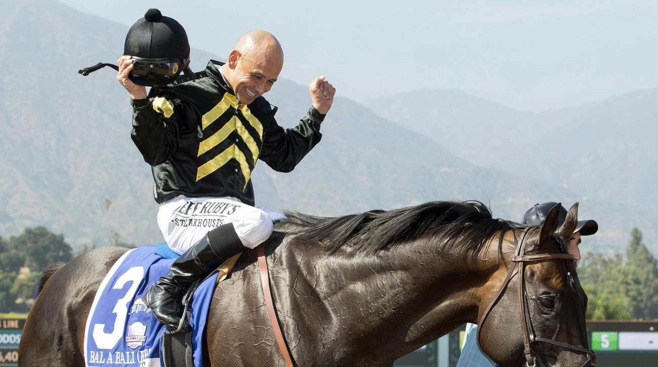 In this image provided by Benoit, Bal a Bali and jockey Mike Smith are guided into the Winner's Circle after winning the Grade I, $400,000 Shoemaker Mile horse race Saturday, June 3, 2017, at Santa Anita Park in Arcadia, Calif. (Benoit Photo via AP)