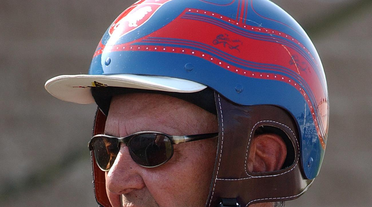 FILE - In this June 23, 2002, file photo, Herve Filion makes his return to harness racing at Harrington Raceway in Harrington, Del. Filion, the Hall of Fame harness racing driver won retired in 2012 with a then-North American record of 15,179 victories, d