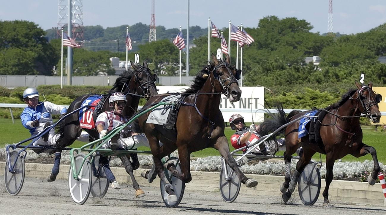 FILE - In this Aug. 5, 2006, file photo, Glidemaster (8), driven by John Campbell, pulls away from Chocolatier (10), driven by Doug R. Ackerman and Blue Mac Lad (2), driven by George Brennan, to win the Hambletonian harness race at Meadowlands Racetrack i