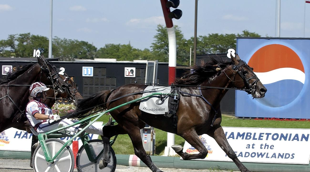 FILE - In this Aug. 5, 2006, file photo, Glidemaster, driven by John Campbell, wins the Hambletonian at Meadowlands Racetrack in East Rutherford, N.J. Campbell bids farewell to the Meadowlands, making his final drives at the track that helped the Hall of