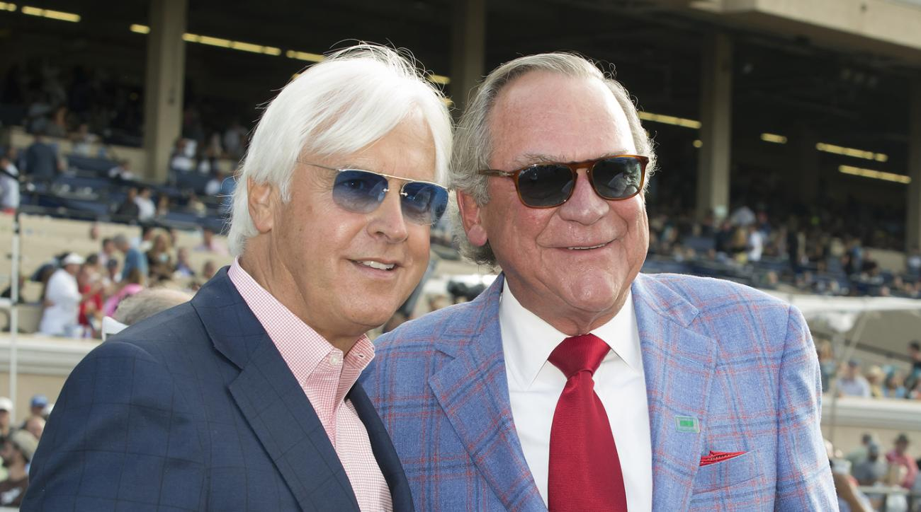 In a photo provided by Benoit Photo, owner Peter Fluor, right, celebrates with trainer Bob Baffert, left, after Collected's victory in the Grade I, $1 million TVG Pacific Classic horse race, Saturday, Aug. 19, 2017, at Del Mar Thoroughbred Club in Del Mar