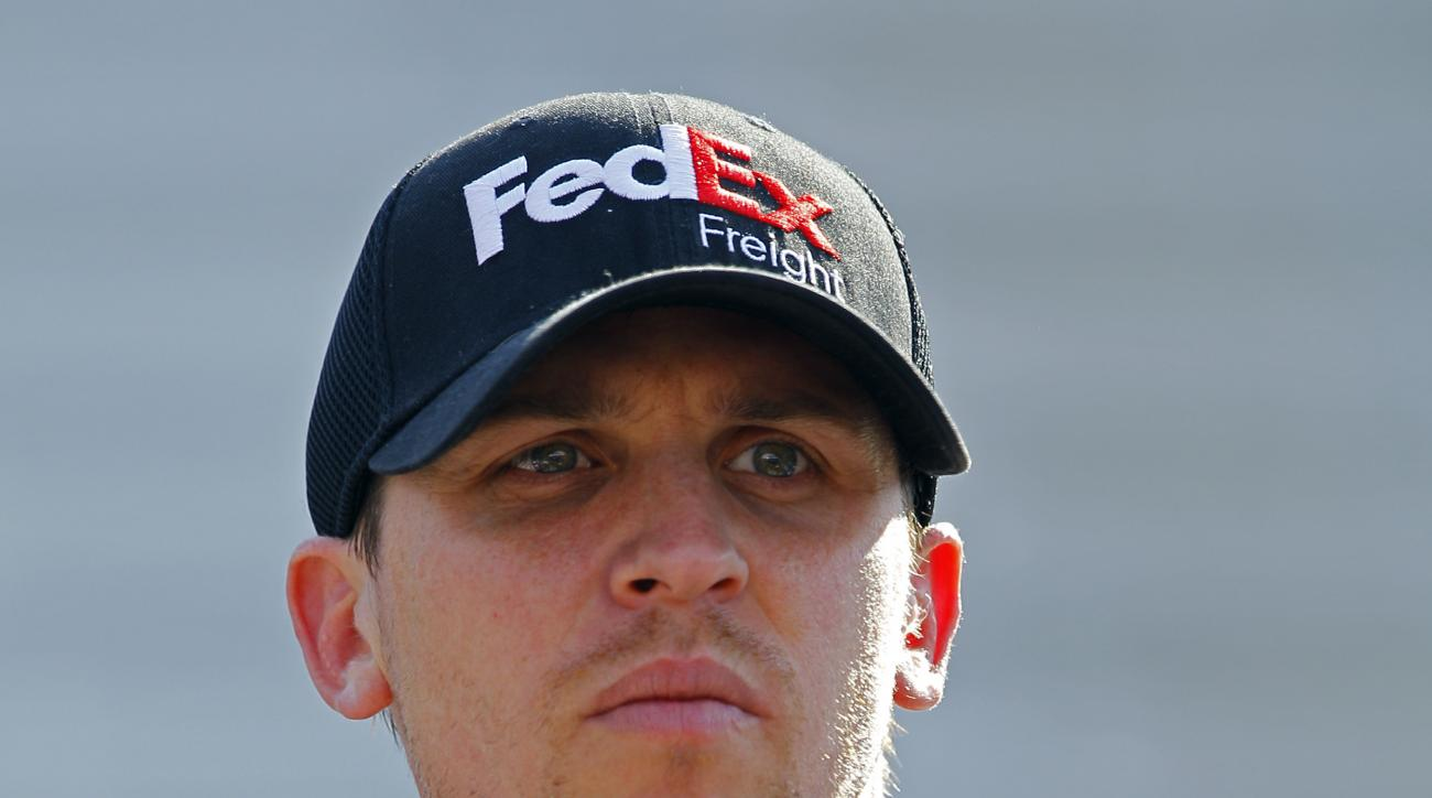 Driver Denny Hamlin looks at the time tower during practice for a NASCAR Sprint Cup Series auto race at Bristol Motor Speedway on Saturday, April 18, 2015, in Bristol, Tenn. (AP Photo/Wade Payne)