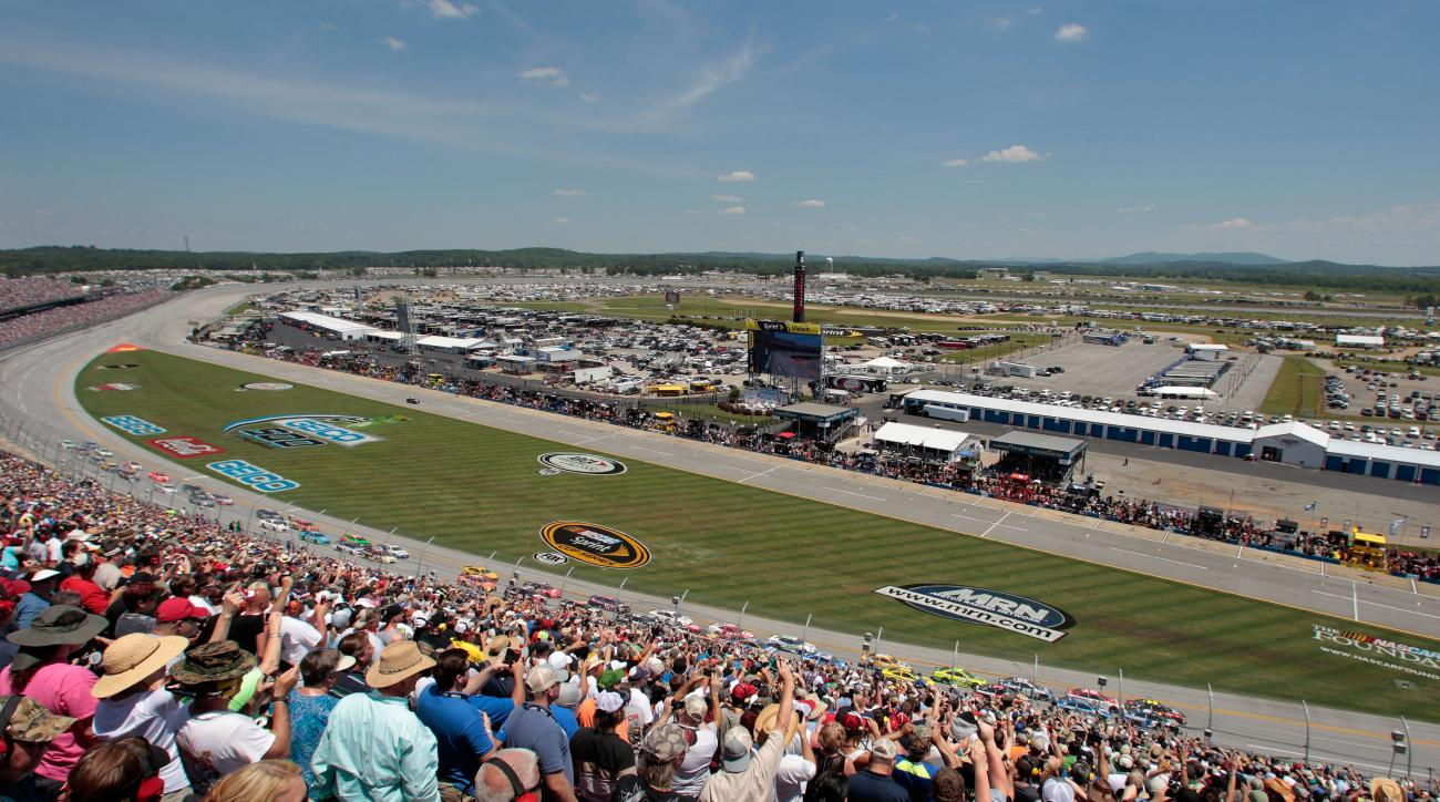 Race fans cheer the start of the Talladega 500 NASCAR Sprint Cup Series auto race at Talladega Superspeedway, Sunday, May 3, 2015, in Talladega, Ala. (AP Photo/Butch Dill)