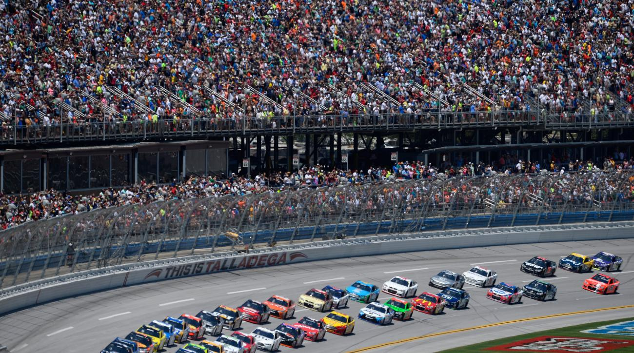 Jeff Gordon (24) and Kasey Kahne (5) lead a pack of cars past the main grandstands during the first lap of the Talladega 500 NASCAR Sprint Cup Series auto race at Talladega Superspeedway, Sunday, May 3, 2015, in Talladega, Ala. (AP Photo/David Tulis)