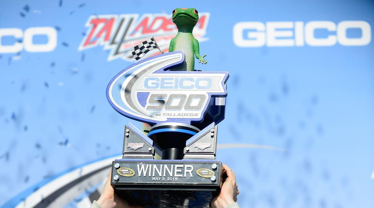 Dale Earnhardt Jr. hoists the trophy in Victory Lane after winning the Talladega 500 NASCAR Sprint Cup Series auto race at Talladega Superspeedway, Sunday, May 3, 2015, in Talladega, Ala. (AP Photo/David Tulis)