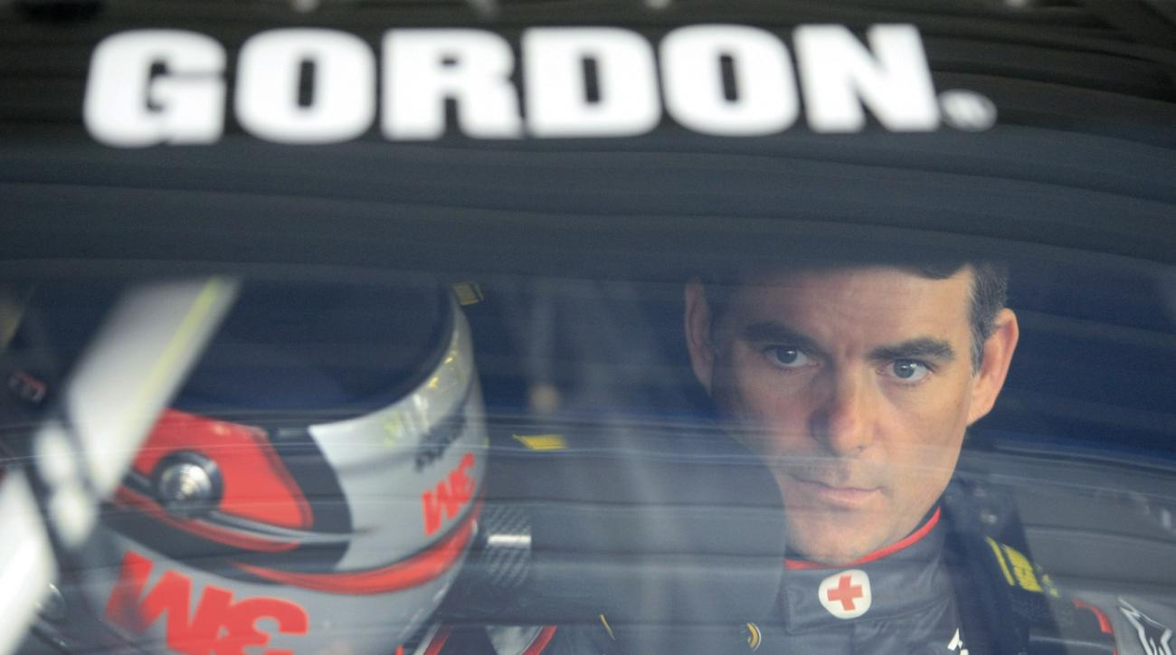 NASCAR driver Jeff Gordon waits in his car during practice for Saturday's Sprint Cup Series auto race at Kansas Speedway in Kansas City, Kan., Friday, May 8, 2015. (AP Photo/Colin E. Braley)