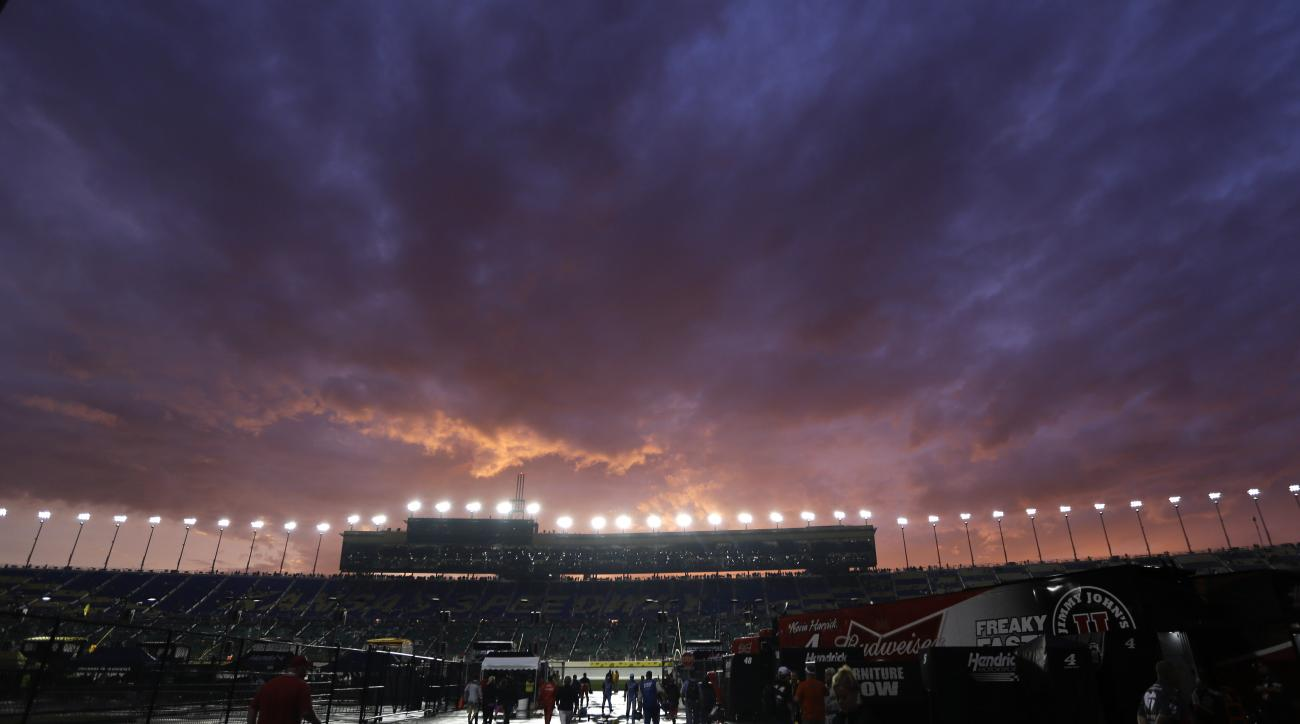 Skies start to clear during a rain delay in the Sprint Cup Series auto race at Kansas Speedway in Kansas City, Kan., Saturday, May 9, 2015. (AP Photo/Orlin Wagner)
