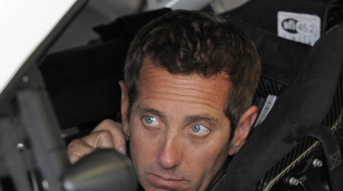 Greg Biffle waits in his car before practice for Sunday's NASCAR Coca-Cola 600 Sprint Cup series auto race at Charlotte Motor Speedway in Concord, N.C., Thursday, May 21, 2015. (AP Photo/Mike McCarn)