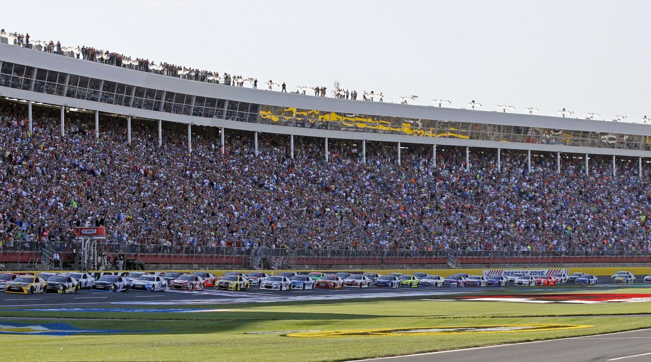 The field takes the green flag to start the NASCAR Sprint Cup series auto race at Charlotte Motor Speedway in Concord, N.C., Sunday, May 24, 2015. (AP Photo/Terry Renna)
