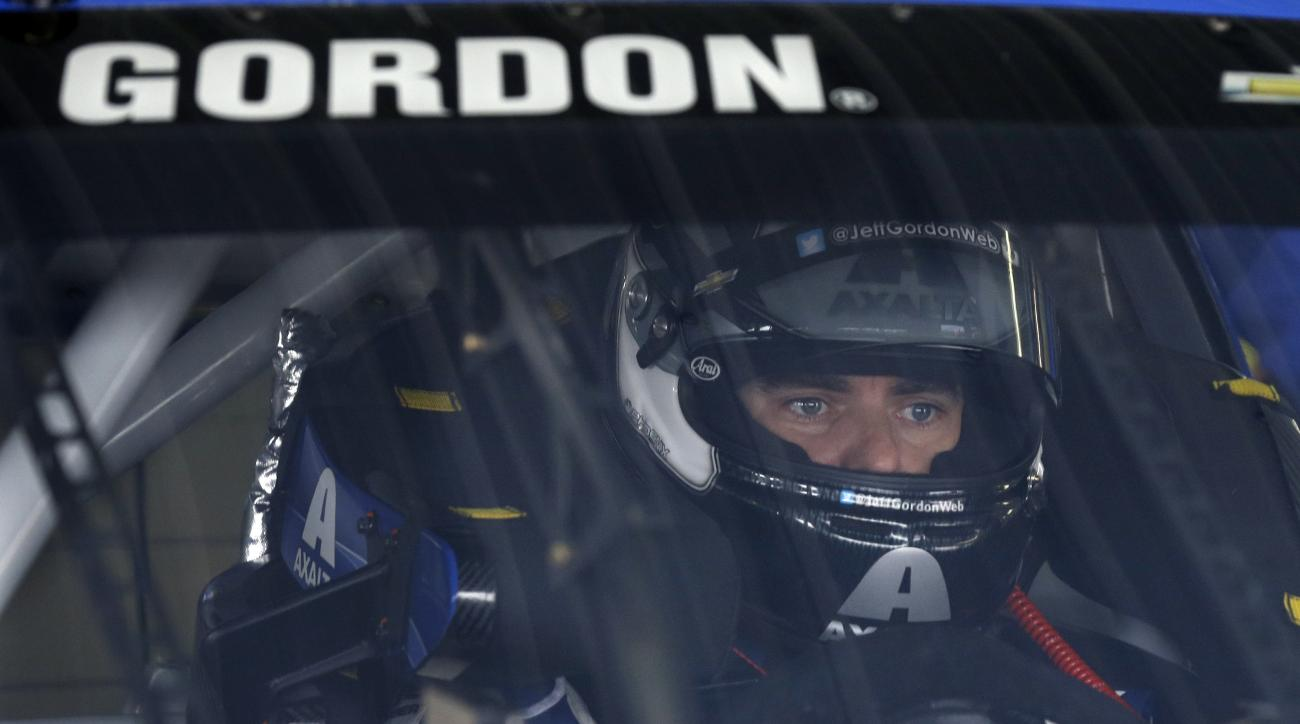 Jeff Gordon (24) waits in his race car at Pocono Raceway during practice for Sunday's NASCAR Sprint Cup Series auto race in Long Pond, Pa., Saturday, June 6, 2015. (AP Photo/Mel Evans)