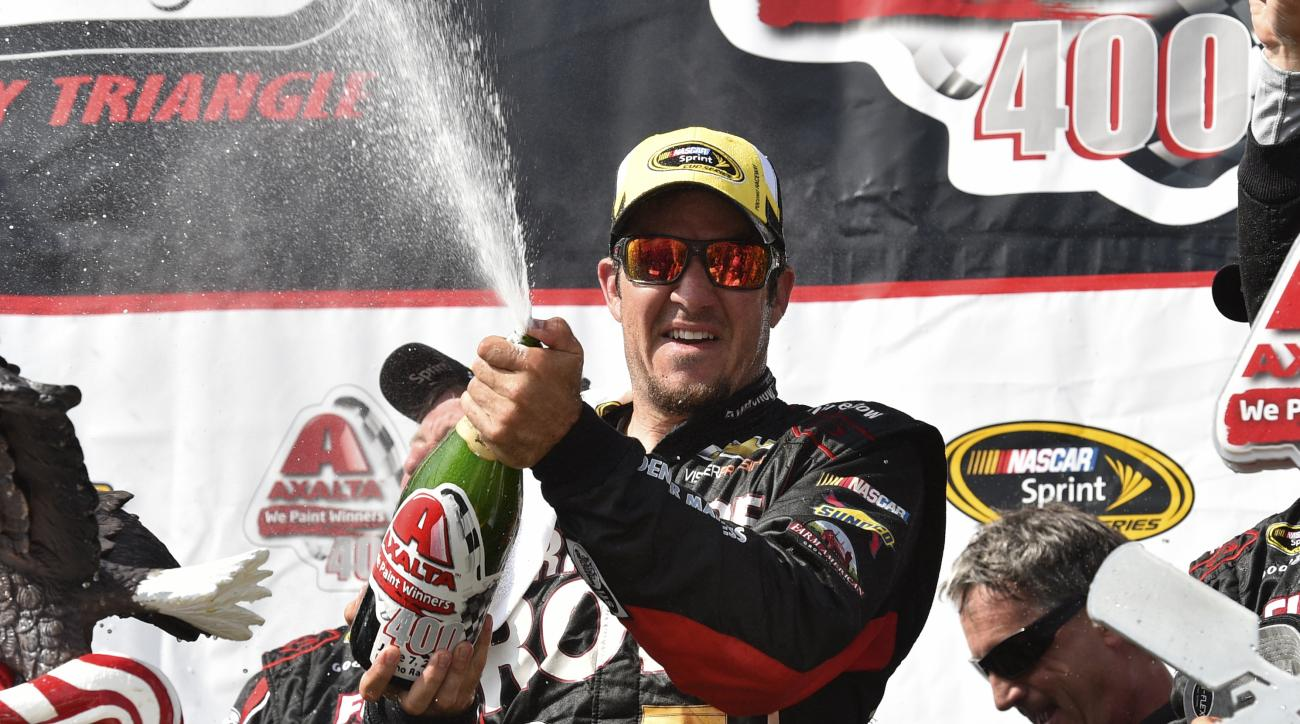 Martin Truex Jr. celebrates in Victory Lane at Pocono Raceway after winning a NASCAR Sprint Cup Series auto race at Pocono Raceway in Long Pond, Pa., Sunday, June 7, 2015. (AP Photo/Derik Hamilton)